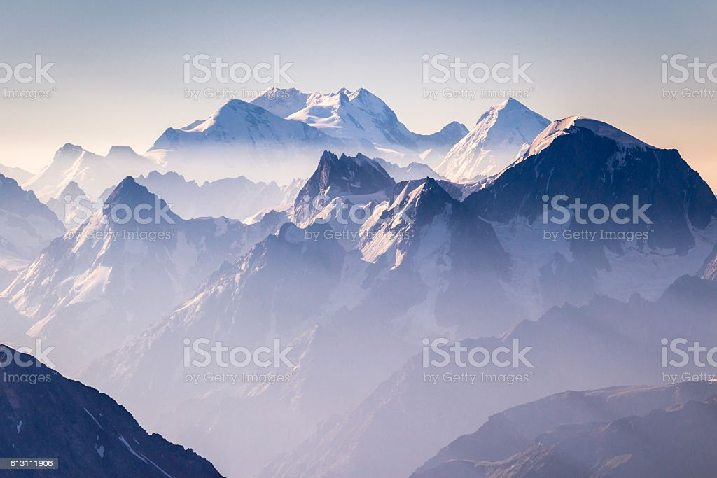 Misty blue mountains on sunrise stock photo