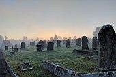 Misty sunrise at a graveyard