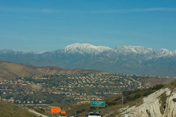 A misty distant view of Mt. Baldy in San Antonio A scenic view of Mt. Baldy in Southern California. san bernardino california stock pictures, royalty-free photos & images