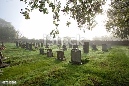 Misty early morning over a Village Cemetary