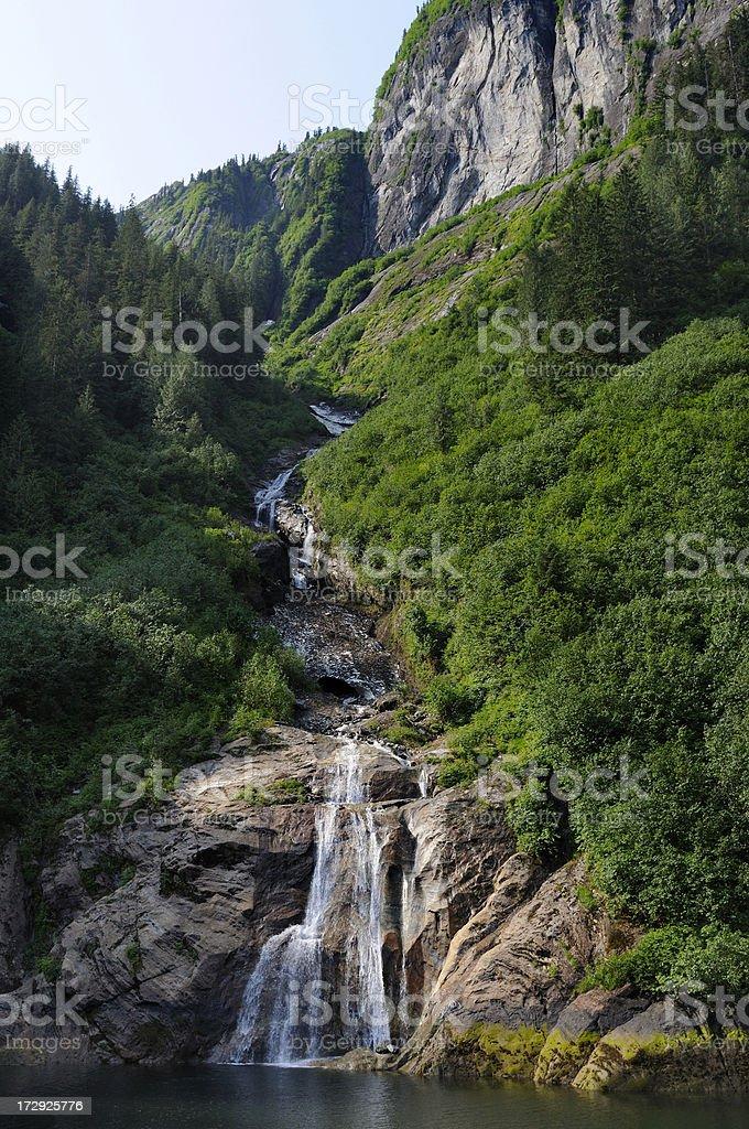 Misty fjords waterfall. stock photo