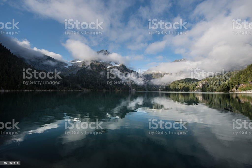 Misty green Lake stock photo