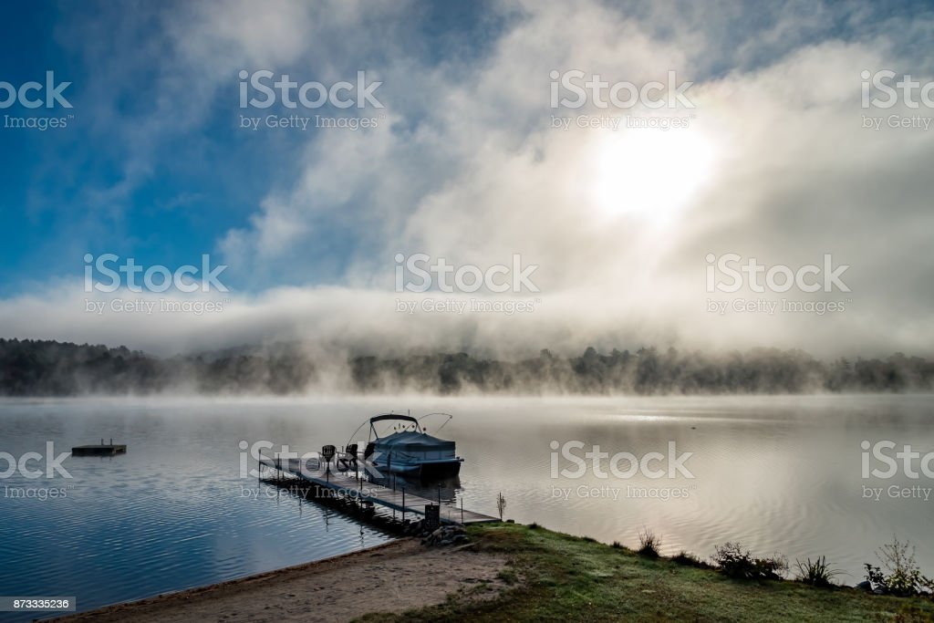 Misty lake in the fall stock photo