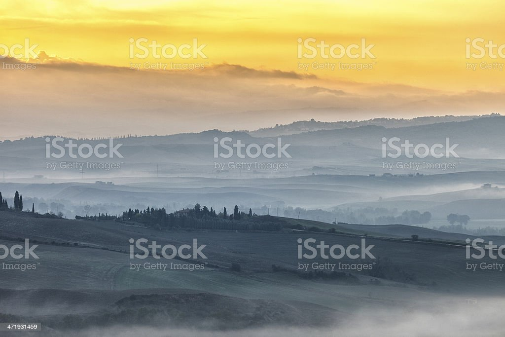 Misty Landscape at Dawn in Tuscany, Italy royalty-free stock photo