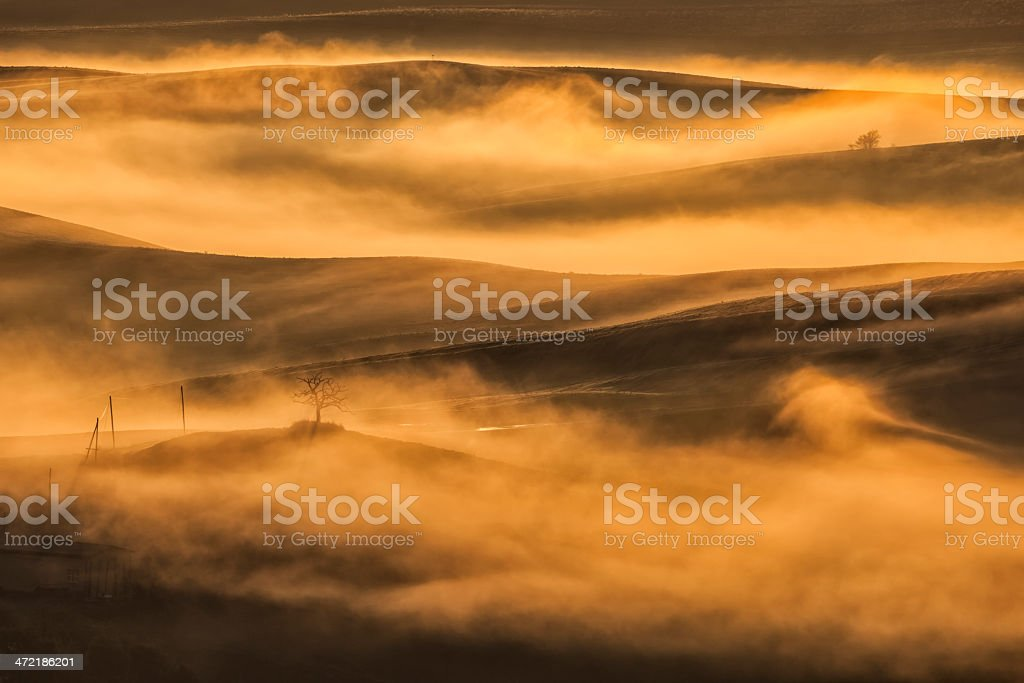 Misty Landscape at Sunrise, Tuscany, Italy royalty-free stock photo