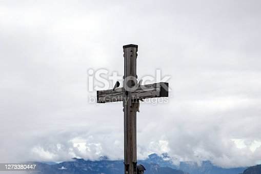 Alpine Cross for travelers in the Bavarian Alps close to Hitler's Eagles Nest and the German village of Berchtesgaden, Cross of Kehlstein moody sky