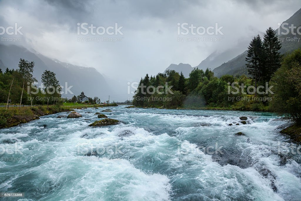 Misty landscape with Oldeelva glacier river in Norway stock photo