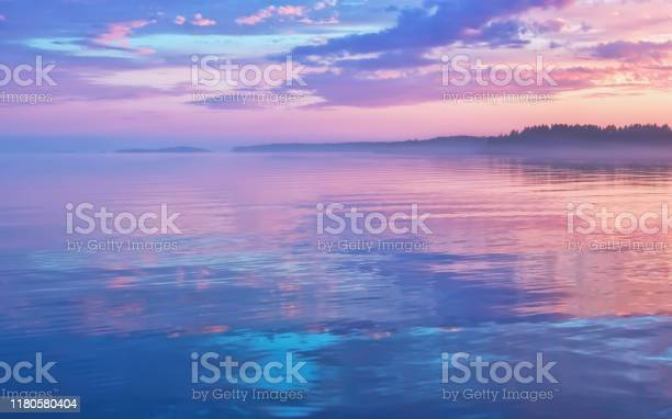 Photo of Misty Lilac Sunset Seascape With Sky Reflection