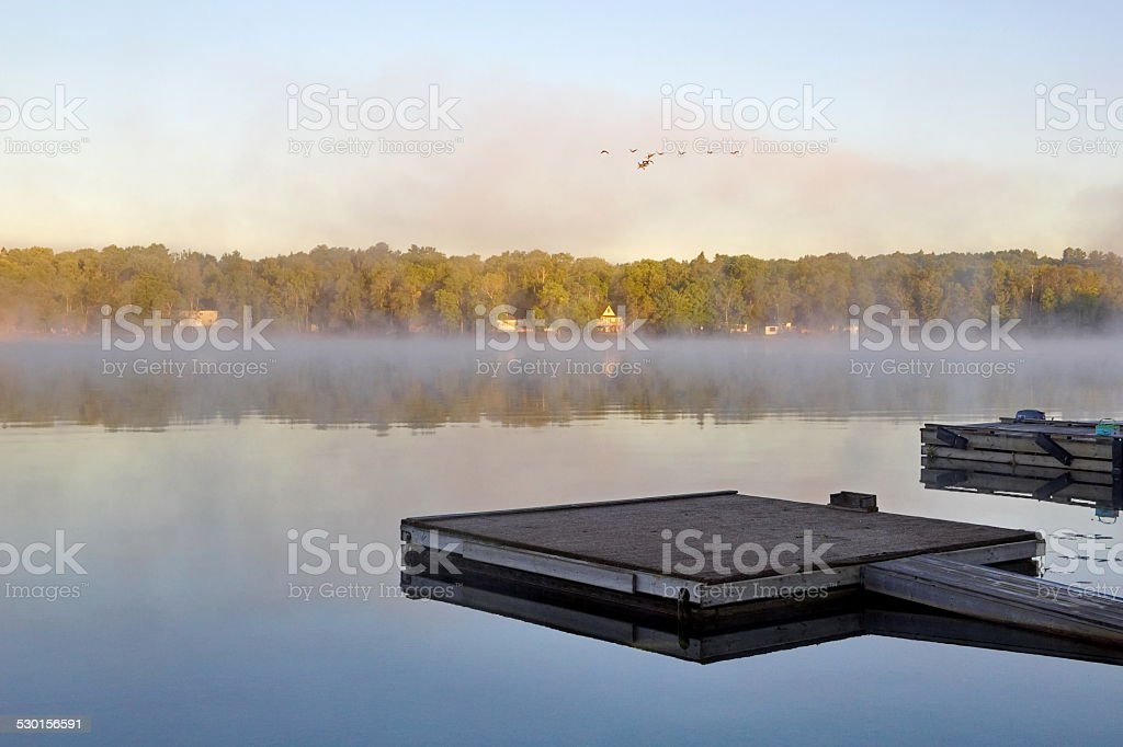 Misty morning at the dock stock photo