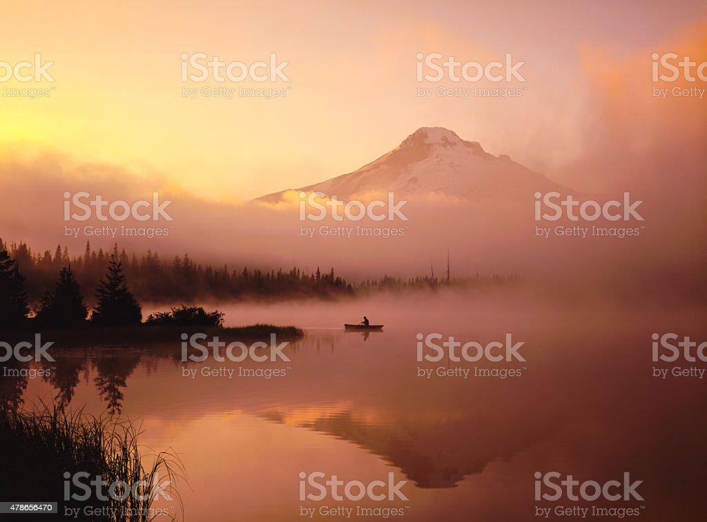 Misty morning, canoe, with the reflection of  Mt. Hood, OR stock photo