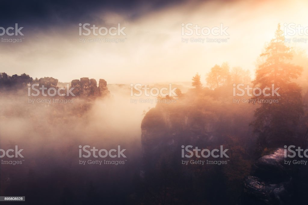 Misty morning in the Elbe Sandstone Mountains stock photo