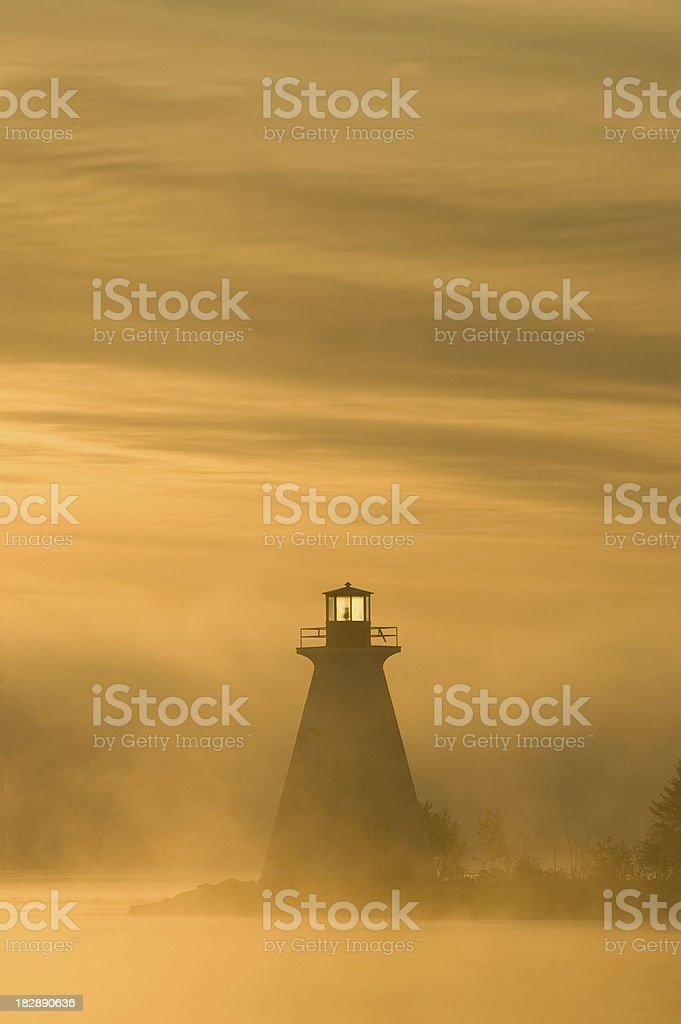 Misty morning lighthouse royalty-free stock photo