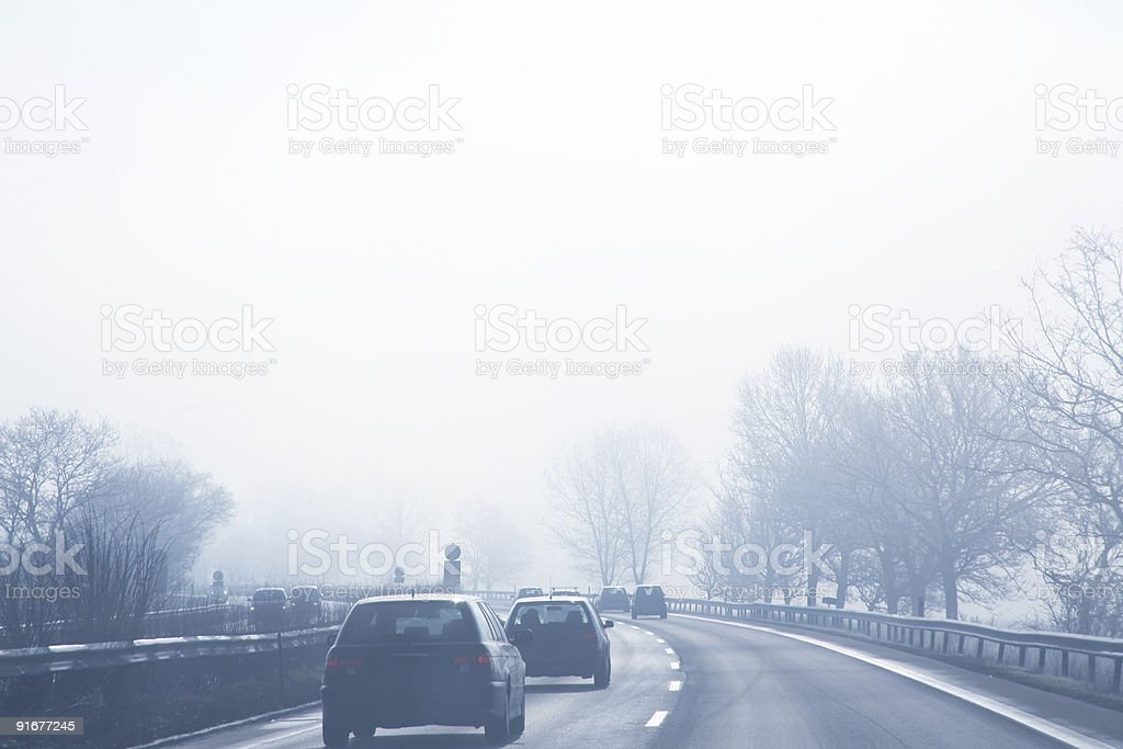 Misty morning on the autobahn royalty-free stock photo