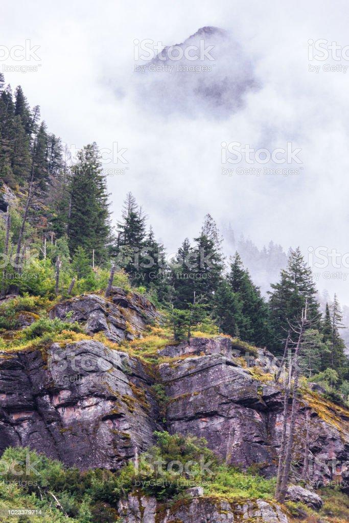 Misty mountain peak stock photo