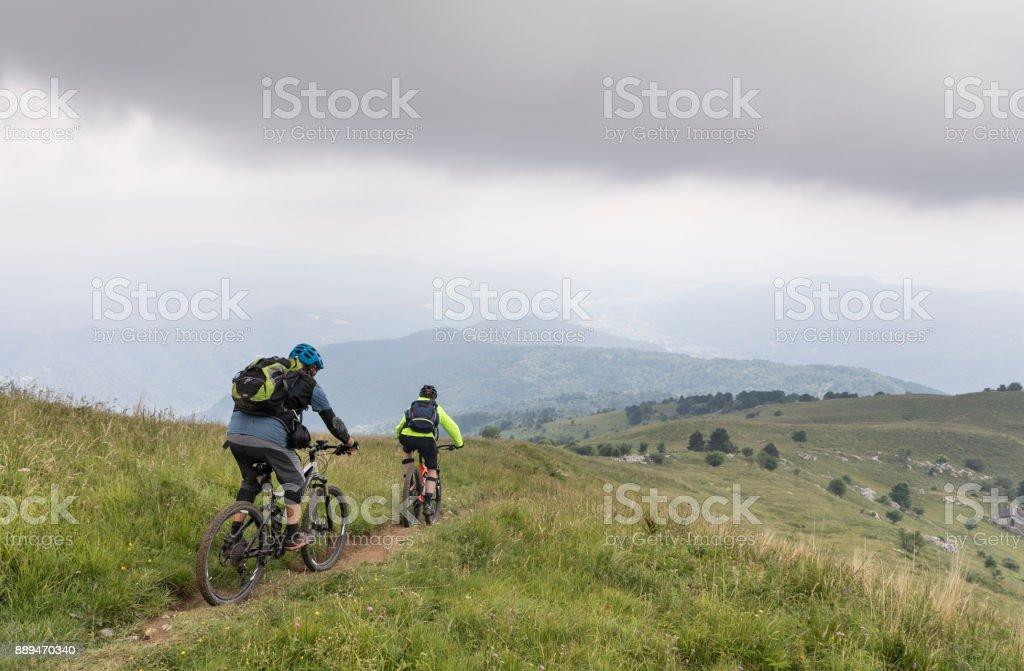 Misty mountainbike downhill in the Julian Alps, Slovenia stock photo