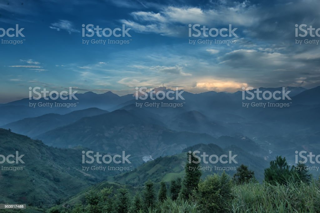 Misty mountains at dawn stock photo