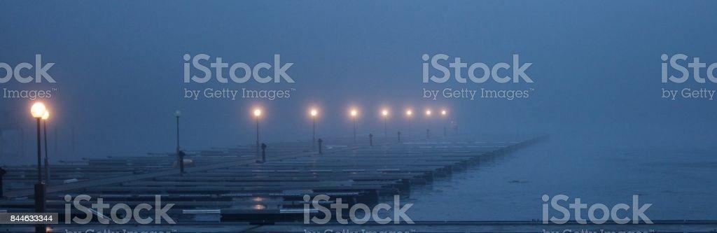 Misty pier II stock photo