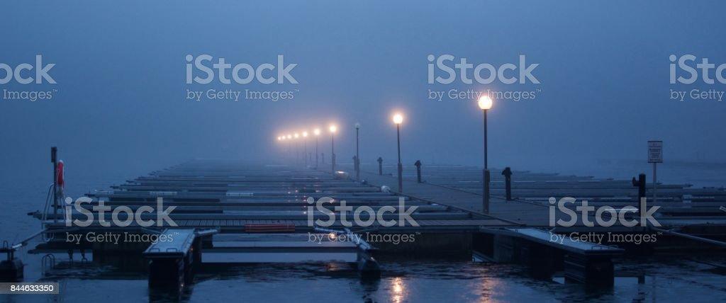 Misty pier stock photo