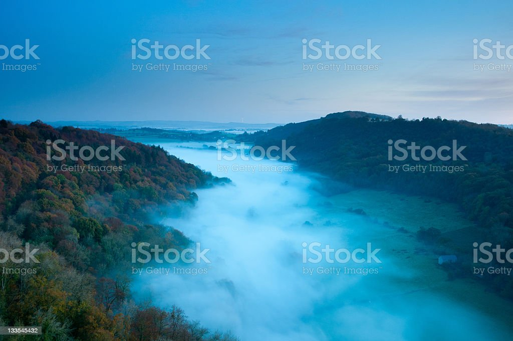 Misty river valley stock photo