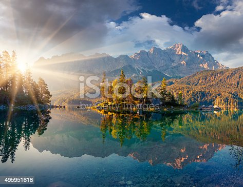 Misty summer morning on the Eibsee lake in German Alps. Germany, Europe.