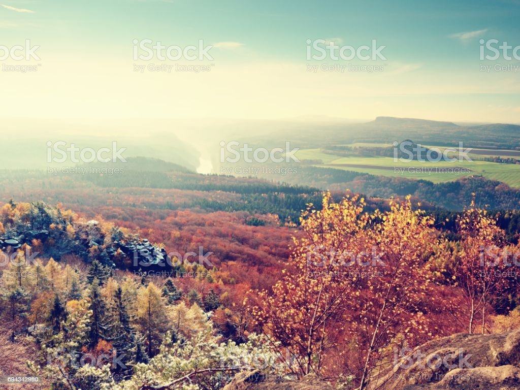 Misty sunrise in the mountains, the gradation of color clouds. Misty daybreak in a beautiful hills stock photo