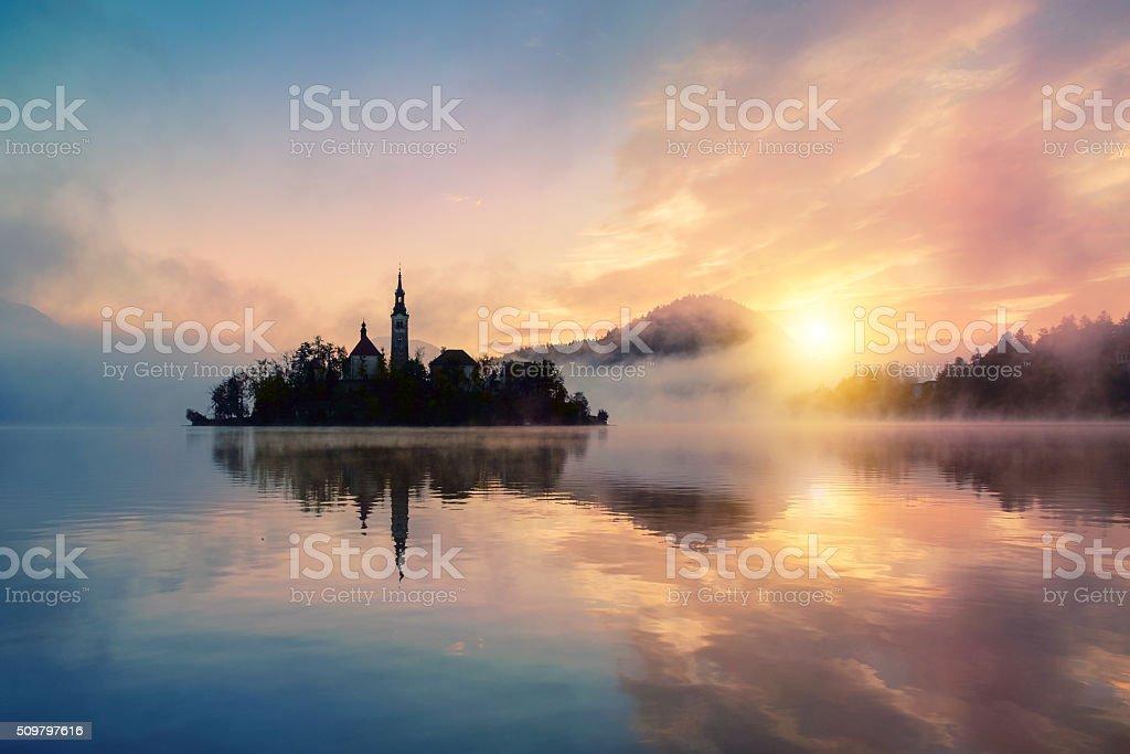 Misty sunrise to lake Bled stock photo