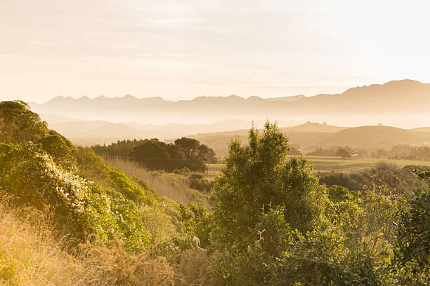 Misty sunset landscape of ranges in the distance stock photo