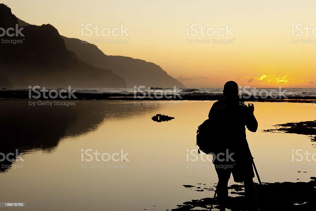 Misty sunset on Na Pali coastline royalty-free stock photo