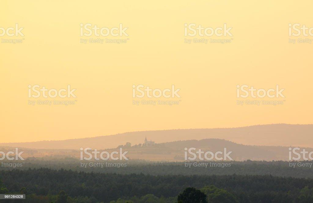 Misty sunset stock photo