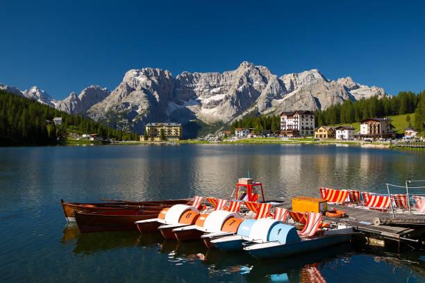 Misurina lake in summer on sunrise with no tourists, Dolomites, Alps, Italy stock photo