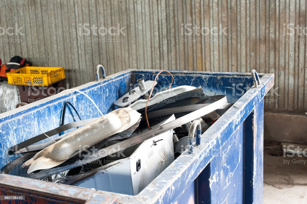 Mitallic container full of industrial iron waste products. stock photo