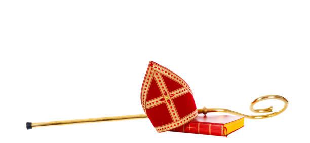 Mitre miter staff saint nicholas. Dutch sinterklaas Mitre or miter and staff of saint nicholas. Isolated on white background. Sinterklaas border sinterklaas stock pictures, royalty-free photos & images