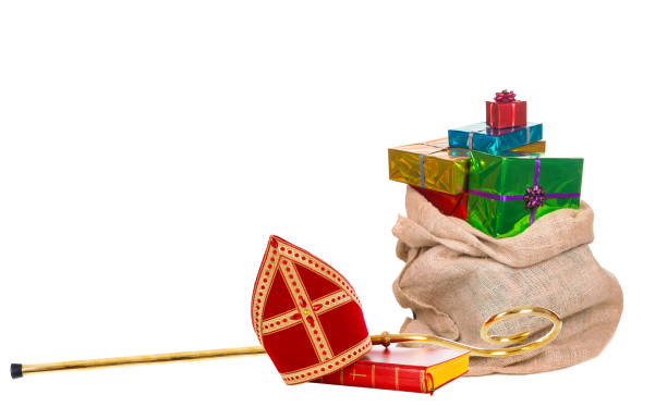 Mitre or miter and sack with gifts of saint nicholas. Dutch sinterklaas Mitre or miter sack with gifts and staff of saint nicholas. Isolated on white background. Sinterklaas border sinterklaas stock pictures, royalty-free photos & images