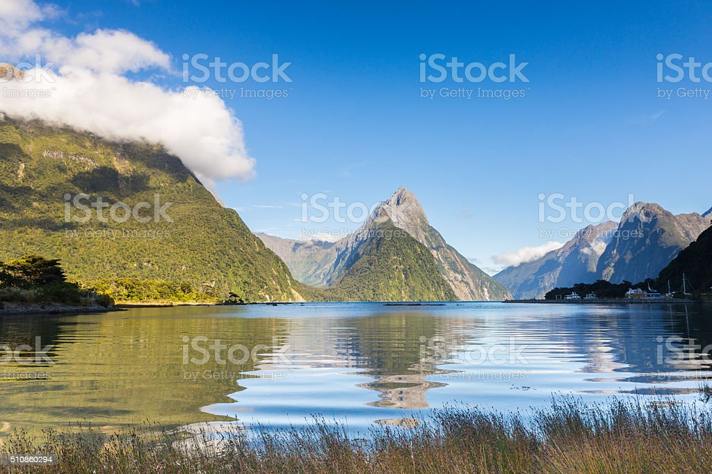 Mitre Peak and its reflection in the quiet morning stock photo