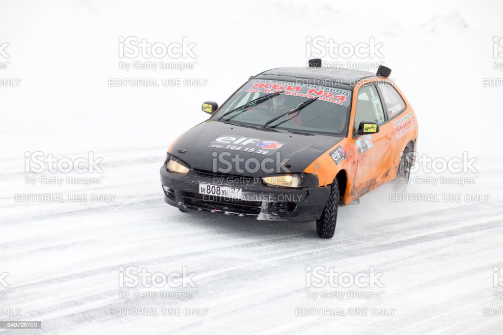 Mitsubishi at winter ice track race on frozen river stock photo