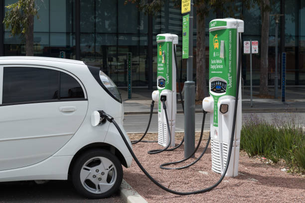 Mitsubishi i-MiEV at Plug-In Electric Vehicle Charging Station in Franklin Street, Adelaide CBD, South Australia stock photo