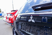 istock Mitsubishi logo on a Mitsubishi car at a car dealer 1143613967