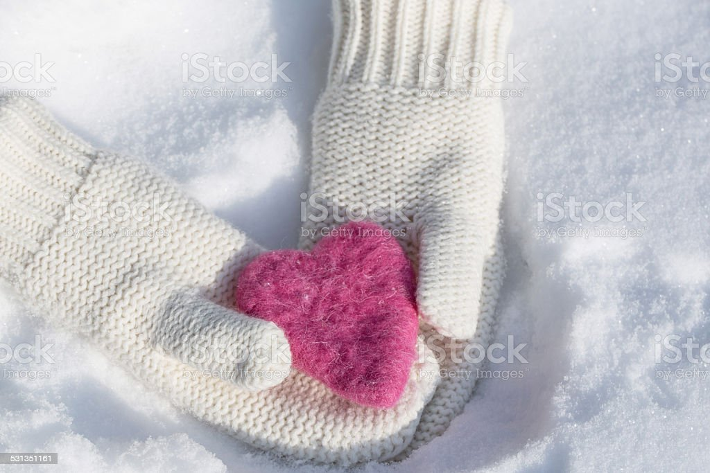 Mittens Holding Valentines Day Love Heart stock photo
