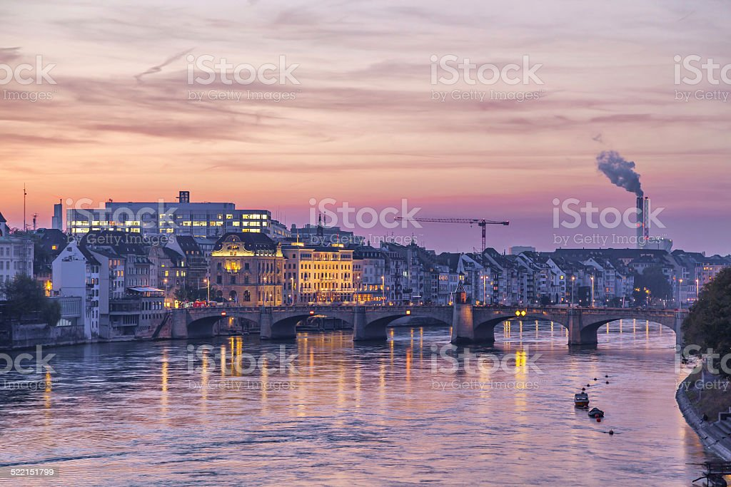 Mittlere bridge over Rhine and city skyline at sunset, Basel stock photo