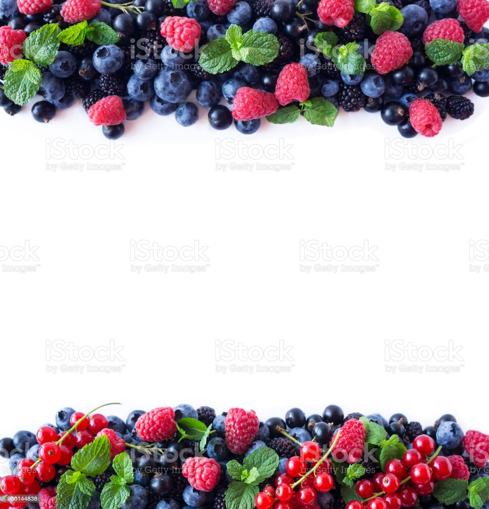 Mix berries and fruits at border of image with copy space for text. Ripe blueberries, blackberries, raspberries and currants on white background. Background berries. Various fresh summer berries. Top view. stock photo