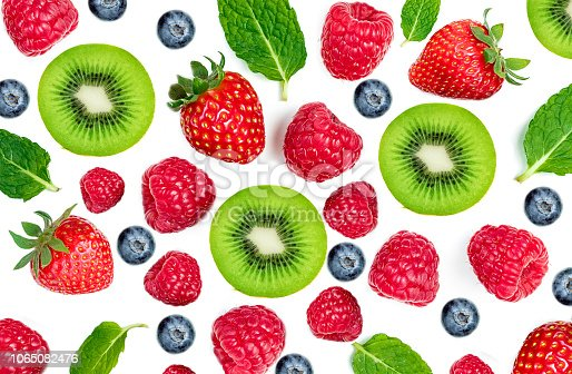 istock Mix  berries isolated on white background, top view. Strawberry, Raspberry, KIWI fruits, Blueberries  and Mint leaf, flat lay 1065082476
