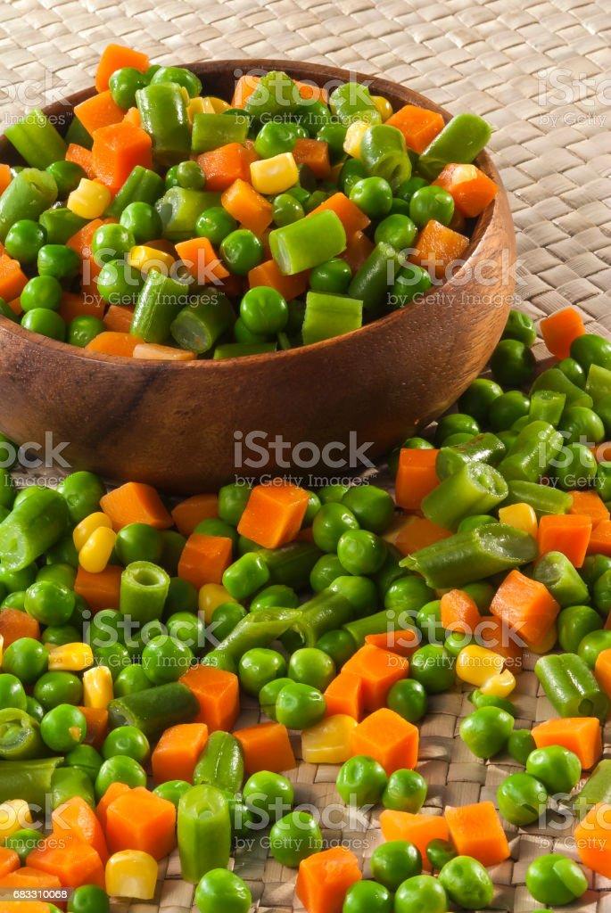 Mix cut vegetable in wooden bowl zbiór zdjęć royalty-free