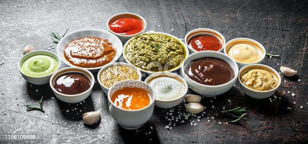 Mix from different kinds of sauces. On dark rustic background