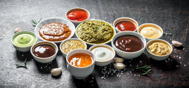 Mix from different kinds of sauces. Mix from different kinds of sauces. On dark rustic background sauce stock pictures, royalty-free photos & images