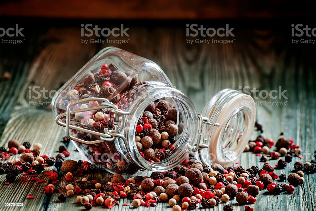 Mix from five peppers in a glass jar stock photo