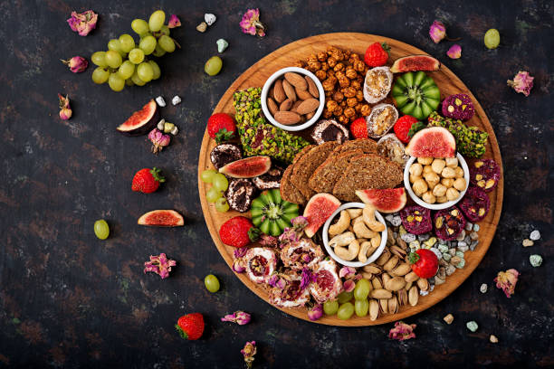 Mix fruits and nuts, healthy diet, Turkish sweets, eating lean. Flat lay. Top view stock photo