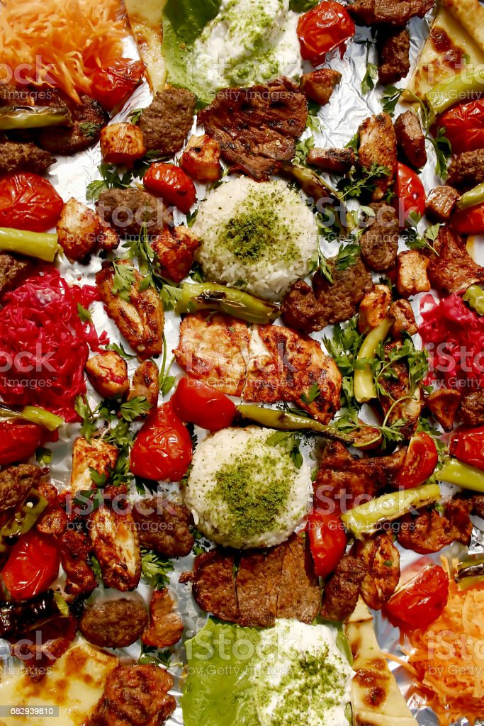 Mix kebab meat and vegetable served with rice royalty-free stock photo