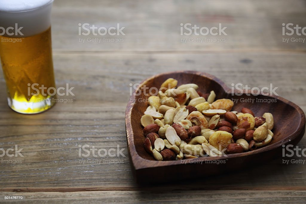 Mix nuts in a heart shaped plate stock photo