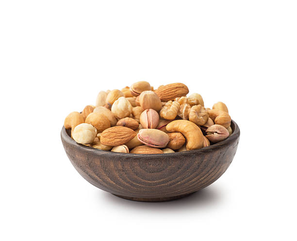 mix nuts with wooden bowl - 硬殼果 個照片及圖片檔
