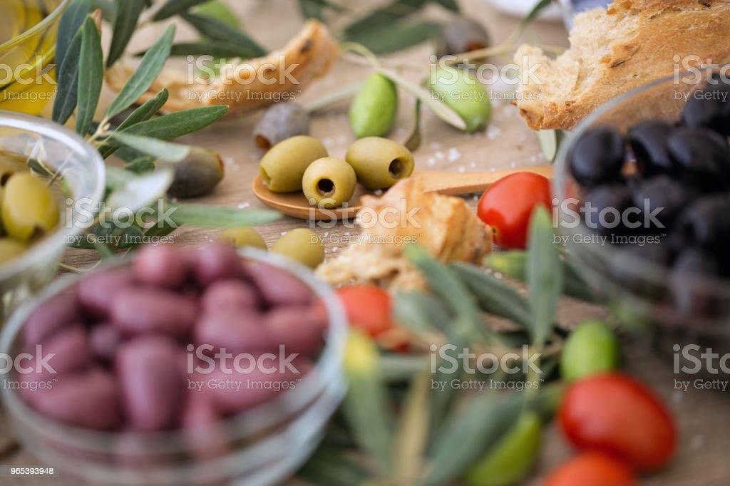 Mix of assorted whole Italian olives royalty-free stock photo